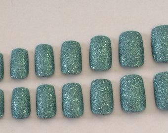 Sparkly fake nails, teal nails, textured nails