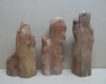 3 cypress knee mittens.