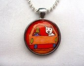 Newly adopted dog rides towards his great, new life! Peach colored car, red background, brown highway. One inch glass pendant.
