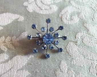 Sky blue rhinestone starburst brooch