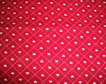 "Red hearts woven cotton . 1 1/4 yard 44"" wide."