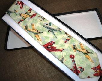 Tie in an aeroplane printed cotton fabric.