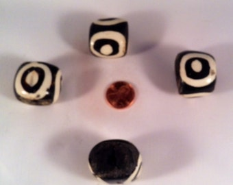 Four extra large mudcloth batkik bone beads with wood core.  Each bead is 85 mm.  Made in Kenya, Africa.