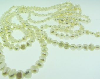 """80"""" long strand of white freshwater pearls."""