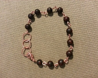 Handmade beaded bracelet, ruby jasper, with copper accents and copper spring clasp