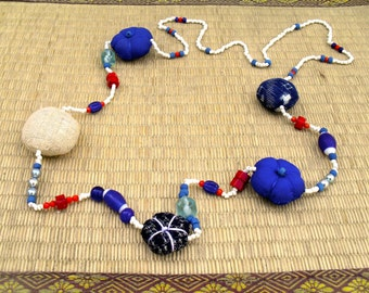 necklace made from beads. handwoven Japanese indigo textiles, cultured pearls. Indian silver, glass beads