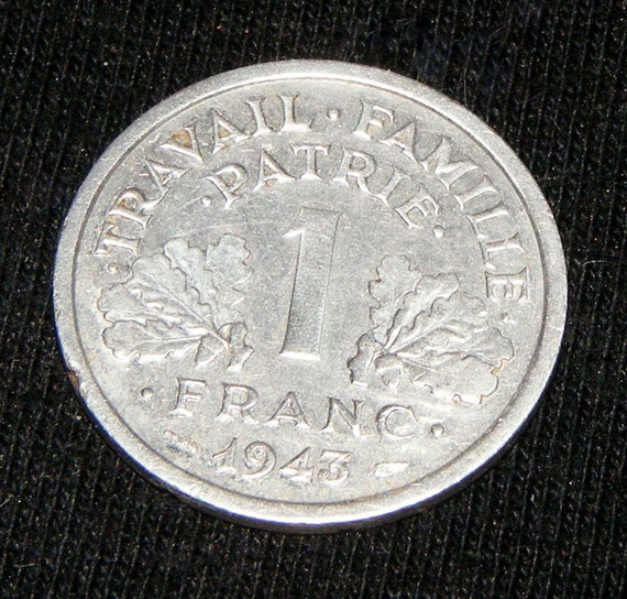 GREAT INVESTMENT . . . 1943 1 Franc Coin