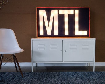 MTL Montreal Handcrafted wooden light bulb sign.