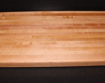 Lots of room with this Solid, maple-wood edge-grain cutting board