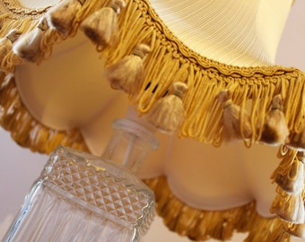 Table lamp - upcycled cut glass bottle with a vintage gold lampshade
