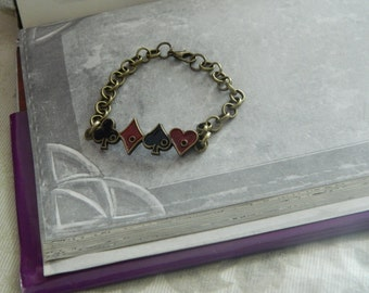 Alice in wonderland bracelet with symbols playing cards