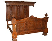 7434 Heavily Carved Antique Bed Executed in Walnut