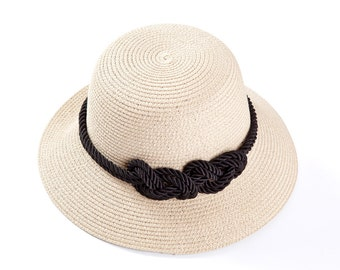 Custom hats , women's hats , Off white hat decorated with a sailor rope & a nautical knot.