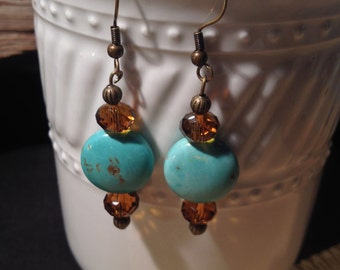 Hand made earrings with turquoise bead accented with beautiful amber glass bead.