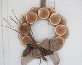 Natural Wood Wreath,  made with Yew wood rounds, burlap and pine cones!