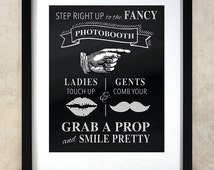 Step right up to the fancy photobooth chalkboard sign. Great when trying to direct guests at your wedding!