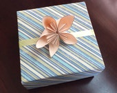 Hand folded paper gift box, blue, cream, green stripes trimmed with green satin ribbon and kusudama paper flower