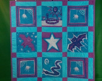 Batiked Flannel Baby Quilt Bats, Snakes and Spiders in Turquoise and Purple