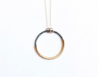 AURIC large gold and oxidized silver circle pendant necklace