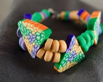 Summer-y green, orange, and purple bracelet – Peruvian Summer