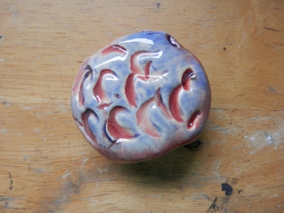 ceramic smoke stone toke stone high fired pottery clay art blue red glazes scales