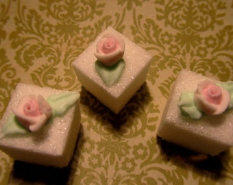 Elegant mini roses on sugar cubes for elegant tea parties
