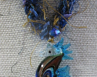 Whimsical glass seahorse pendant with handknit fiber chain