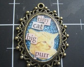 Tiny Cat...Big Purr Pendant, 50% goes to the current selected animal charity