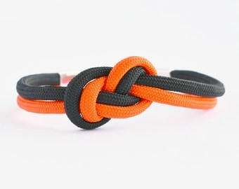 Neon orange and black infinity knot parachute cord rope bracelet