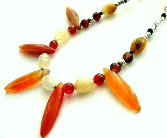 https://www.etsy.com/ie/listing/175447532/red-gemstone-necklace-statement-bib?ref=shop_home_feat_2