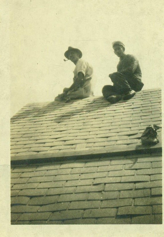 Roofers Working Men Sitting On Roof Shingles Nail By