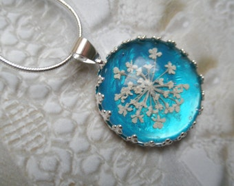 Queen Anne's Lace Beneath Glass Crown Pendant Atop Glowing, Caribbean Ocean Blue Pressed Flower Pendant-Gifts Under 25-Symbolizes Peace