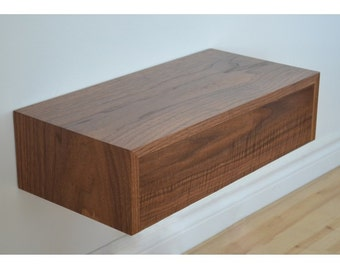 Walnut floating shelf with dovetailed drawer