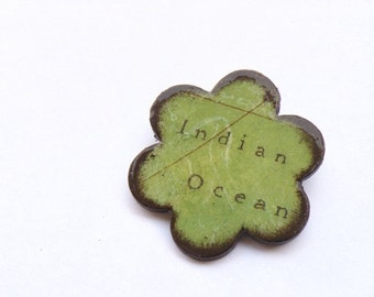 Wooden flower brooch with decoupage of Indian Ocean map