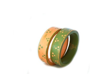 Set of two country bangles in green and orange with polka dots