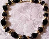 Napier Black Rock Bead Necklace Choker Gold Tone Round Metal Accent Spacers Foldover Clasp Closure