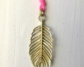 Alexa Feather Pendant in 18k Gold on Fluro Pink Nylon String.  Sacred Artisan Feather to Communicate with Your Higher Power.