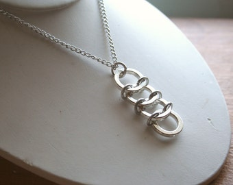 4 Ring Silver Tone Pendant with Chain