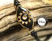 Michal Golan Evil Eye Bracelet in Black with Gold Sun Center