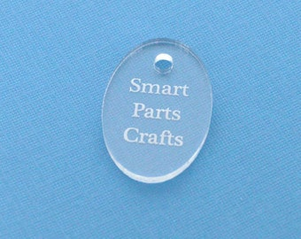 "50 OVAL Custom Acrylic Tags, 1.5"" x 1"" Laser Cut and Engraved, personalize with your company logo or design"