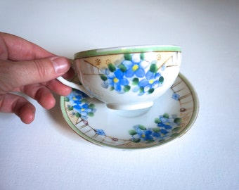 Porcelain Tea Cup and Saucer with Hand Painted Blue Flowers, Green and Gold Trim - Made in Japan TT