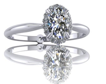 Oval diamond engagement ring set with a diamond halo with claw prongs