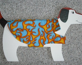 "Fleece Dog Coat size medium (18-22 lbs., 23""+ girth) Hot Flames on Cool Blue with reversible cotton lining."