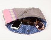 Quilted clutch bag with multi-coloured stripes & polka dot lining