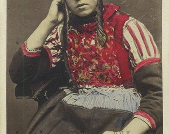 Young woman in ethnic costume Holland antique hand tinted type photo
