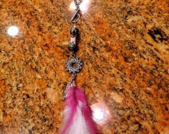 Long beaded silver glass vial necklace with purple and white feathers toggle & clasp