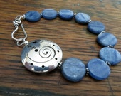Bracelet with Blue Kyanite Gemstone Discs and Sterling Silver Focal Bead with Funky Cutout Symbols
