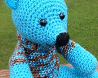 cute aqua color bear with blue and brown mixed shirt