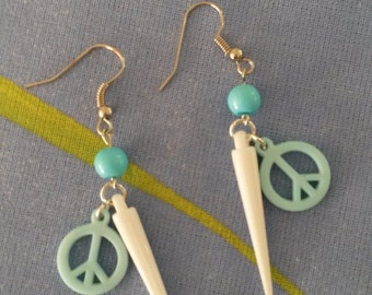 Ibiza style long dangling white earrings with blue bead and peace charm