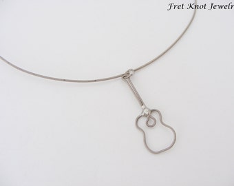 artistic heart necklace guitar string by fretknotjewelry on etsy. Black Bedroom Furniture Sets. Home Design Ideas